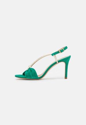 ARLINO - Sandály - green