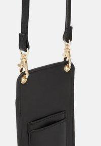 Lindex - MOBILECASE JENNIE - Phone case - black - 3