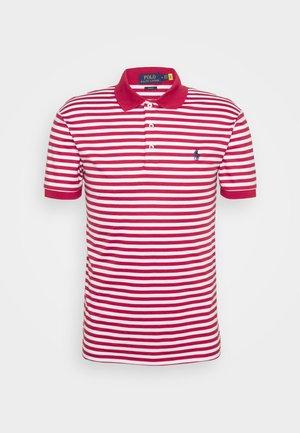 INTERLOCK - Polo shirt - sunrise red/white