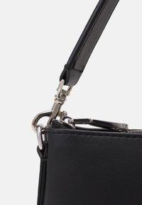 Calvin Klein Jeans - SHOULDER POUCH - Kabelka - black - 3
