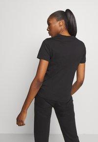 Champion - CREWNECK LEGACY - Print T-shirt - black - 2