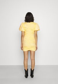 Nly by Nelly - THE CUTEST RUCHED DRESS - Cocktail dress / Party dress - light yellow - 2