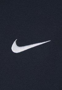 Nike Golf - DRY FIT ESSENTIAL SOLID - Sportshirt - obsidian/white - 2