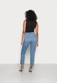 Gina Tricot - DAGNY HIGHWAIST - Jeans Tapered Fit - mid blue - 2