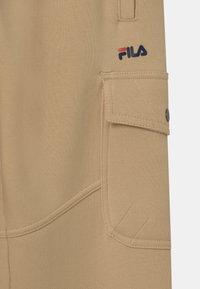 Fila - ELIA  - Teplákové kalhoty - irish cream - 2