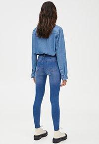 PULL&BEAR - MIT HALBHOHEM BUND - Jeans Skinny Fit - dark blue - 2
