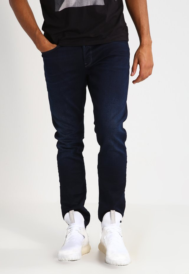 3301 TAPERED - Jeans relaxed fit - dark-blue denim