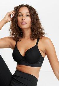 Next - Sports bra - black - 0
