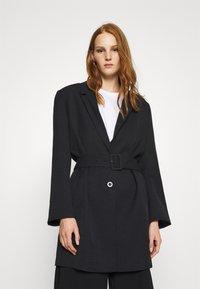 Gestuz - FLEUR - Short coat - black - 0