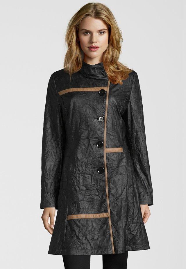 ALMARINA - Halflange jas - black