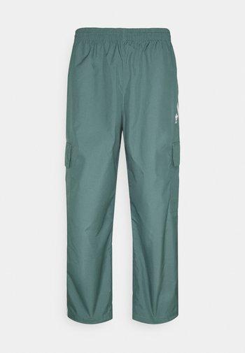 UNISEX - Pantaloni sportivi - hazy emerald