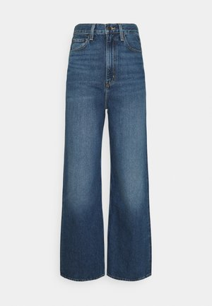 HIGH LOOSE - Flared Jeans - show off