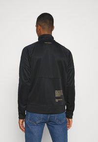 Nike Sportswear - Training jacket - black/gold foil - 2
