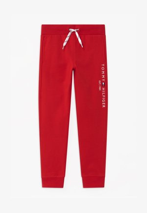 ESSENTIAL UNISEX - Tracksuit bottoms - red
