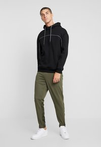 Urban Classics - MILITARY - Tracksuit bottoms - olive - 1