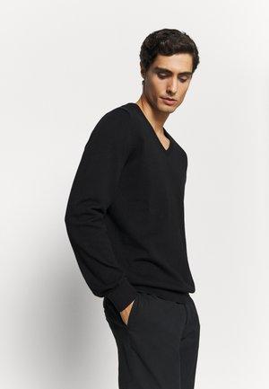 LANGARM - Stickad tröja - black