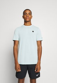 Under Armour - RUSH SEAMLESS FITTED - Sports shirt - enamel blue - 0