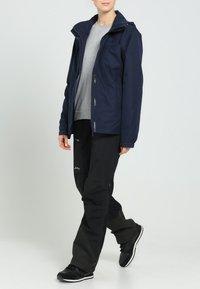 Vaude - WOMANS ESCAPE LIGHT JACKET - Waterproof jacket - eclipse - 0