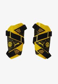 Puma - BVB BORUSSIA DORTMUND FUTURE GUARD - Shin pads - cyber yellow/puma black - 1