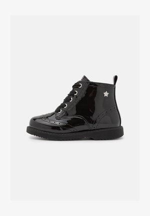 MINI PAT BIKER - Lace-up ankle boots - black