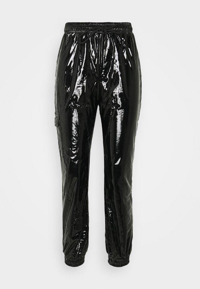 VINYL PANTS - Trousers - blac