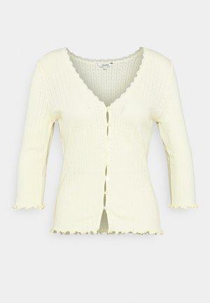 SHASHI - Vest - butter