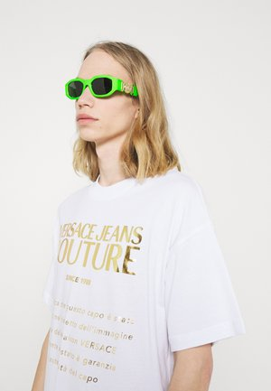 UNISEX - Sunglasses - green fluo