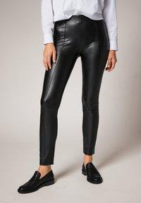 comma - Leggings - Trousers - black - 0