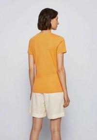 BOSS - T-Shirt print - open yellow - 2