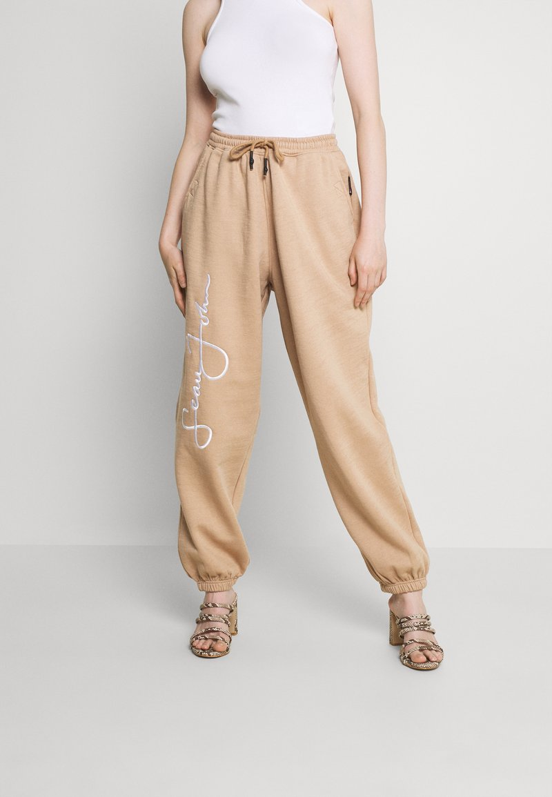 Missguided - SIGNATURE 90S - Tracksuit bottoms - brown