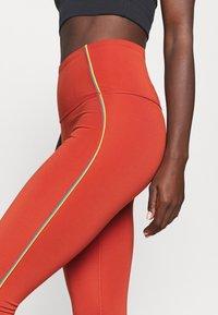 Nike Performance - YOGA CORE 7/8 VINT VINYASA - Tights - firewood orange/claystone red - 5