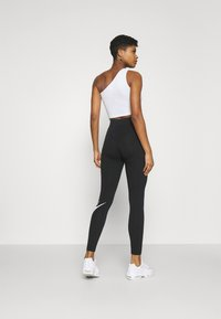 Nike Sportswear - FUTURA - Leggings - black/white