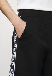 KARL LAGERFELD - LOGO TAPE PANTS - Trousers - black - 3