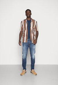 Diesel - D-FINING - Jeans Tapered Fit - blue denim - 1
