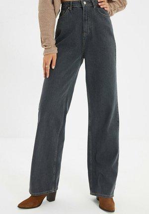 PARENT - Flared Jeans - black