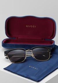 Gucci - Sunglasses - black/gold-coloured/grey - 2