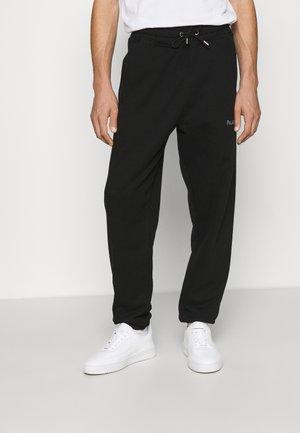 CORE PANTS UNISEX - Träningsbyxor - black