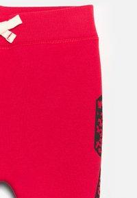 GAP - UNISEX - Trousers - modern red - 2