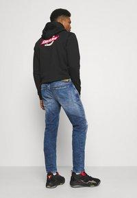 Diesel - SLEENKER - Jeans Skinny - medium blue - 2