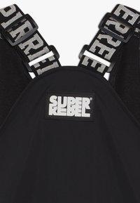 SuperRebel - SKI DUNGAREE  - Zimní kalhoty - black - 3