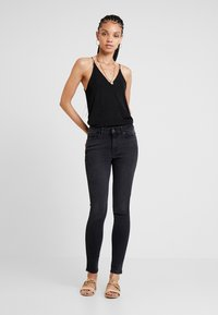 ONLY - ONYANNE MID ANKLE - Jeans Skinny Fit - black denim - 1