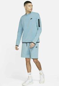 Nike Sportswear - Shorts - cerulean/black - 1