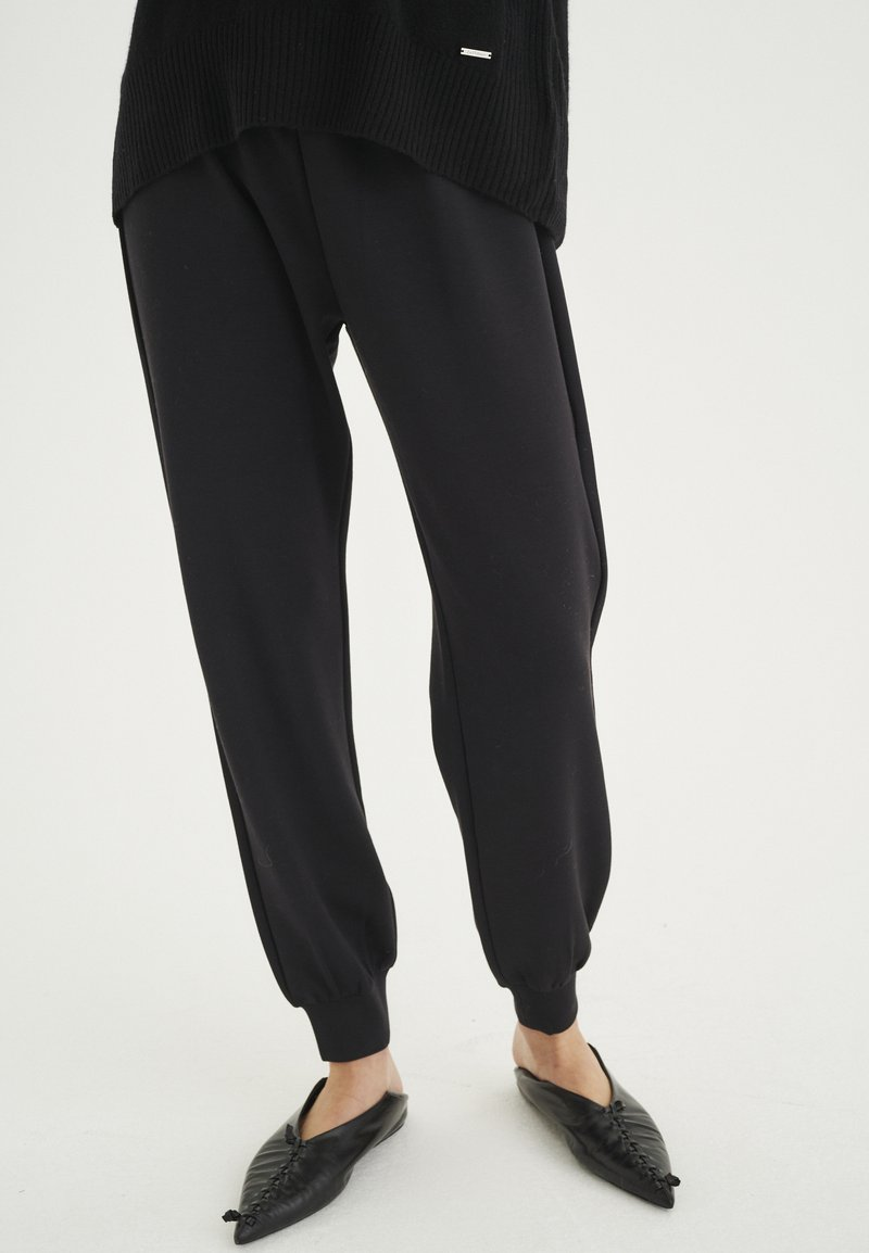 InWear - Tracksuit bottoms - black