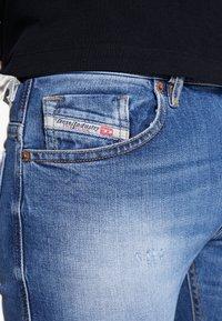 Diesel - THOMMER-X - Slim fit jeans - blue denim - 6