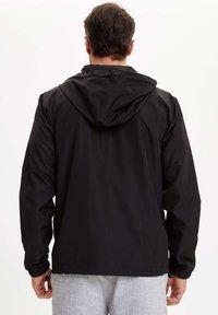 DeFacto - Bluza rozpinana - black - 2