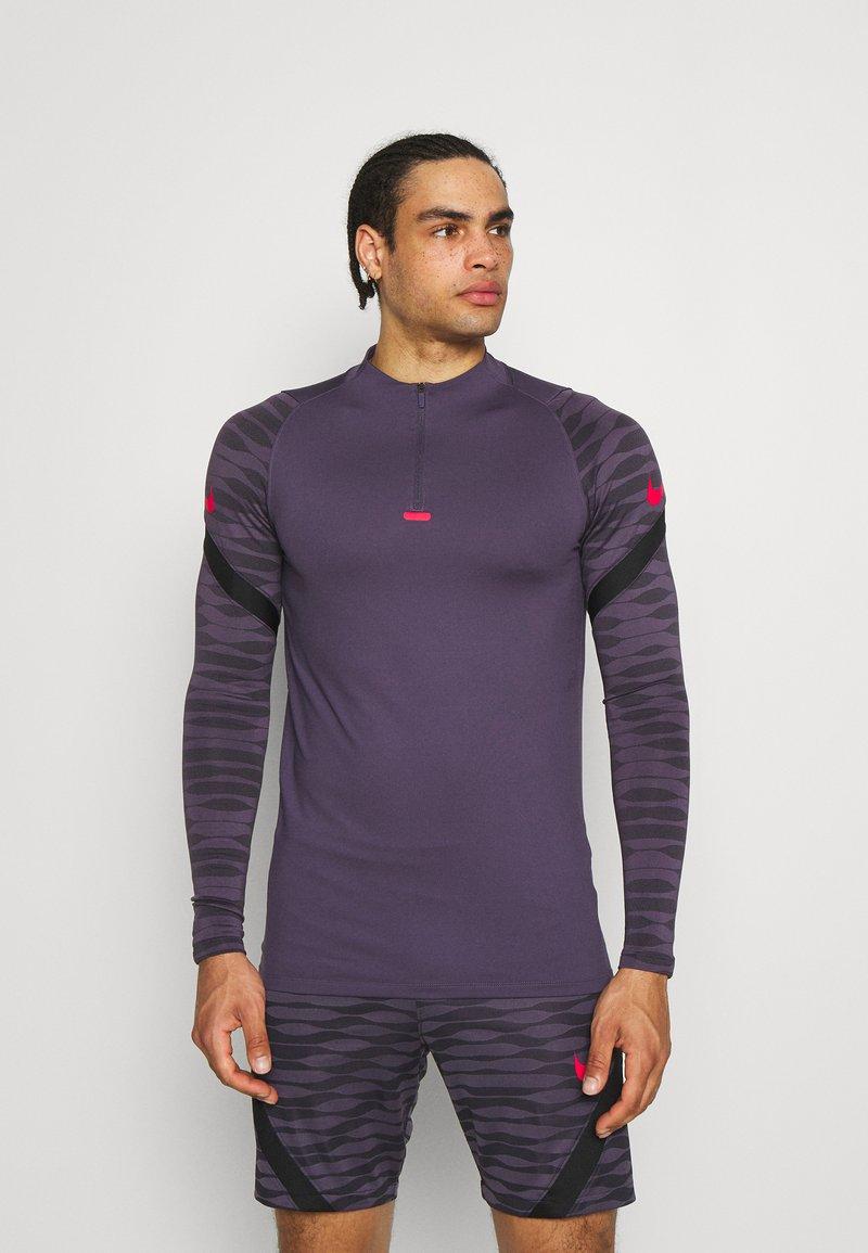 Nike Performance - Sports shirt - dark raisin/black/siren red