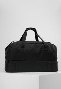 adidas Performance - TIRO DU - Sports bag - black/white - 2