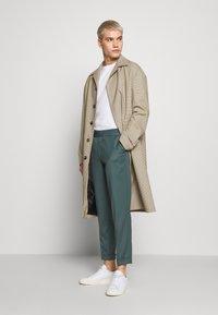 Filippa K - TERRY CROPPED PANTS - Trousers - dark mint powder - 1