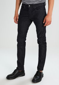 Diesel - THOMMER-X - Slim fit jeans - blue-black - 0