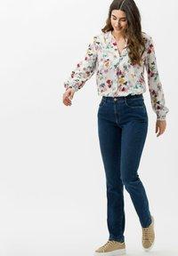 BRAX - STYLE CAROLA - Slim fit jeans - used regular blue - 1